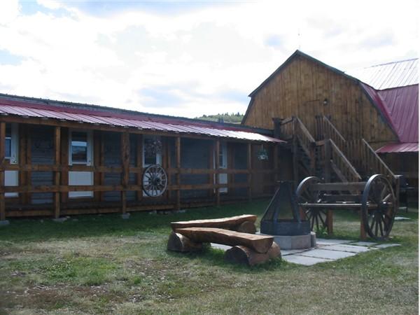 Old Log Barn barnyard firepit at Historic Reesor Ranch.