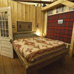 Sarnia Ranch Bedroom in loft of Old Log Barn at Historic Reesor Ranch.