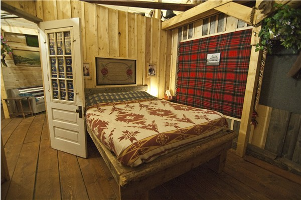 Sarnia Ranch Bedroom in loft of Old Log Barn at Historic Reesor Ranch.