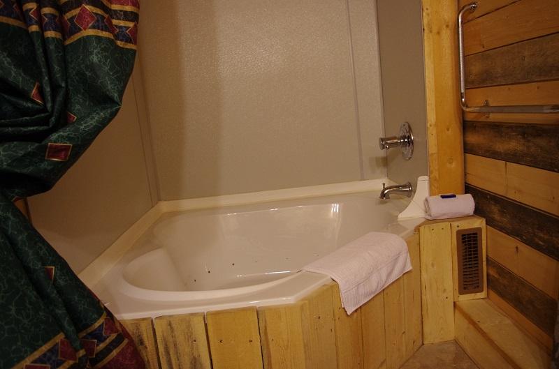 Two person jacuzzi tub built into, enjoy a hot soak!