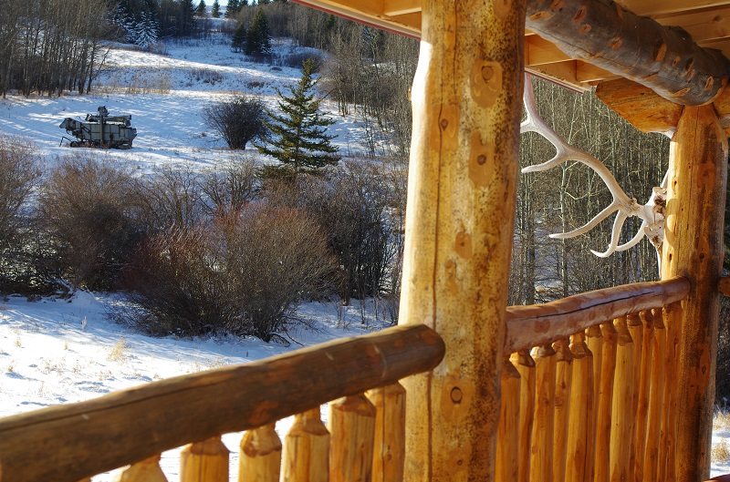Bunkhouse handcrafted log railing by Jason Reesor at Historic Reesor Ranch.
