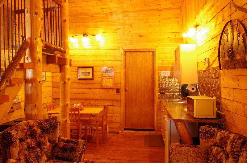 Bunkhouse kitchenette with many amenities. This used to be the woodshed at Historic Reesor Ranch! We call it repurposing the use of an historic building.