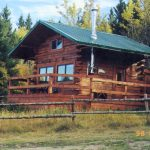 Log Cabin rental nestled by the treeline at Historic Reesor Ranch.
