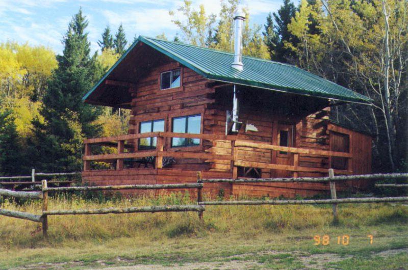 Log Cabin rental nestled by the treeline at Historic Reesor Ranch.