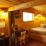 Comfy double bed in Cowboy's Cabin at Historic Reesor Ranch.