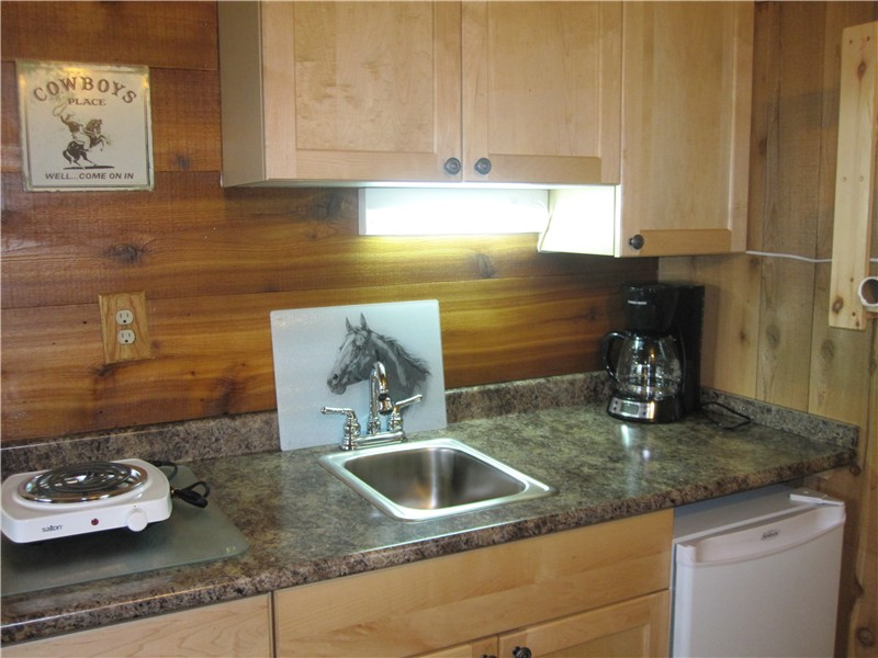 Cozy and functional kitchenette in Cowboy's Cabin at Historic Reesor Ranch.