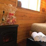 Romance Package in Cowboy's Cabin includes gift basket from Broken Spoke Fine Arts Gallery plus a bottle of Cypress Hills Wine and breakfast at Historic Reesor Ranch.