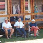 Family & friends relaxing in front of Ranchers' Row at Historic Reesor Ranch