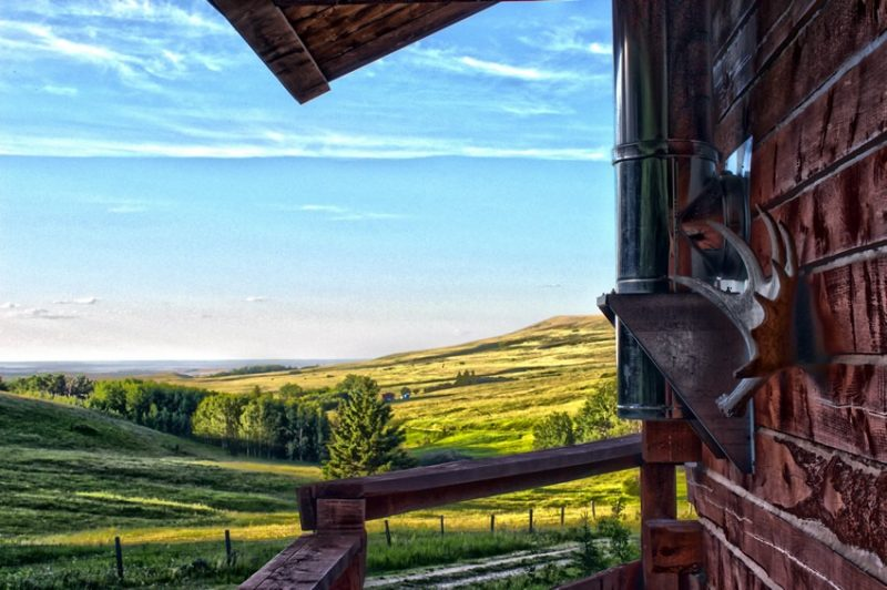 View of north slope of Cypress Hills from Log Cabin deck at Historic Reesor Ranch.