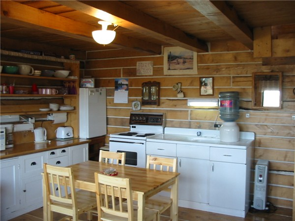 Log cabin cozy living with many amenities at Historic Reesor Ranch.