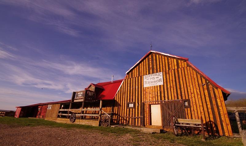 Old Log Barn with main door at Historic Reesor Ranch