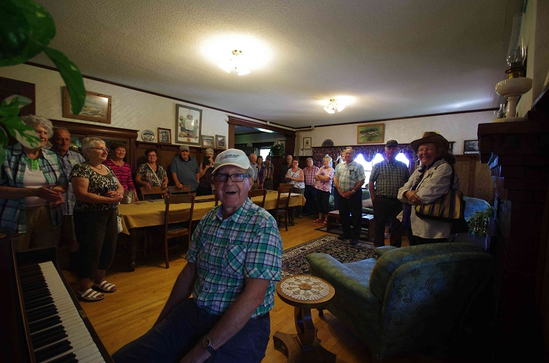 Fun at the piano in the ranchhouse with bus tour from Ontario at Historic Reesor Ranch.