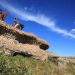 Riders at Conglomerate Rocks at Historic Reesor Ranch.