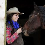 Cowgirl and her horse at Historic Reesor Ranch