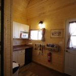 Frontier Cabin kitchenette and front door