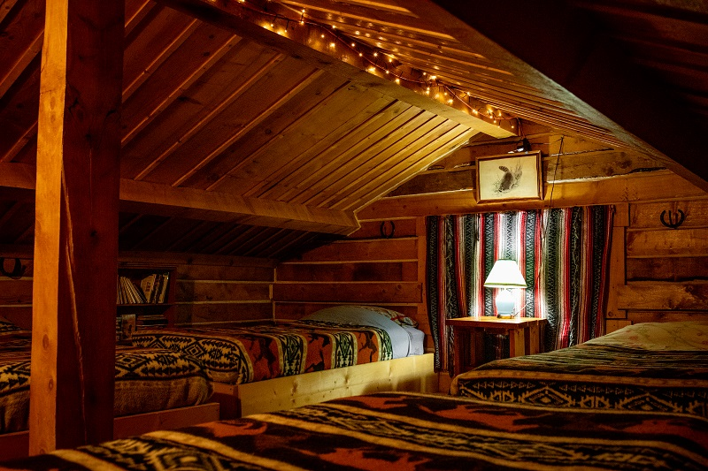 Remind you of GoldiLocks and the Three Bears? Snuggle into four comfy Log Cabin loft beds.